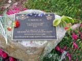 One of our cemetery plaques with flowers